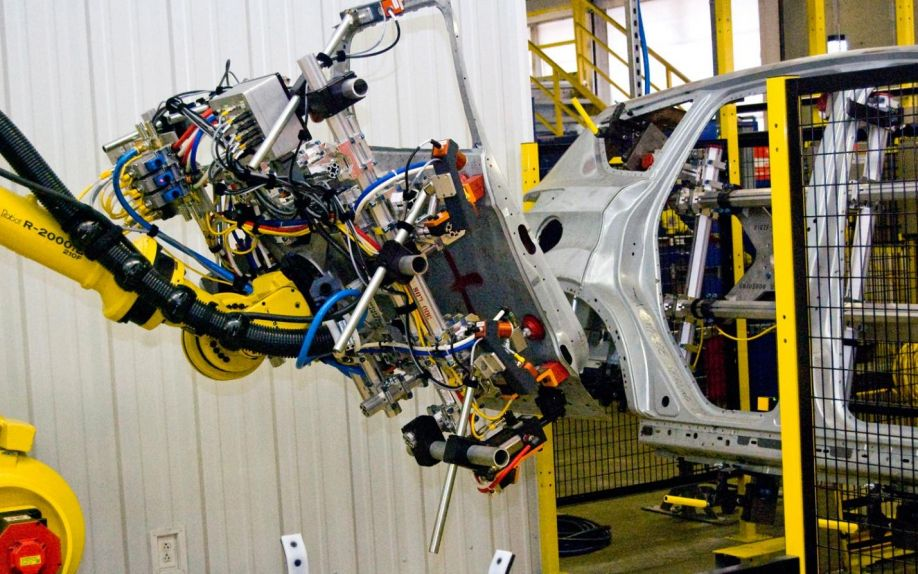 http://st.motortrend.com/uploads/sites/5/2012/04/Ford-Factory-Laser-Eye-Robot-installing-door.jpg